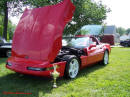 1993 Chevrolet Corvette Red coupe with nice white ZR1 wheels, very clean fine example of Americas number 1 sports car. 40th Anniversary Edition too.